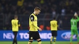 Marco Reus looks dejected at full time as his Dortmund team-mate applaud their support