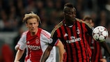 Christian Poulsen and Mario Balotelli contest possession at the Amsterdam ArenA