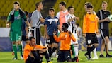 Partizan players celebrate while Shirak's appear dejected at the end of the match