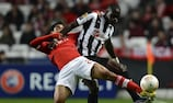 Benfica's Melgarejo (left) tangles with Papiss Cissé during the first leg