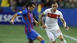 Levante's Pedro Ríos takes on Olympiacos's José Holebas