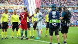 Cameramen get close to the action as Portugal's Cristiano Ronaldo and France captain Hugo Lloris shake hands ahead of the EURO 2016 final