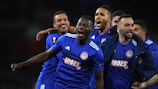 Mohamed Camara celebrates Olympiacos's shock victory over Arsenal in the last 32