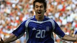Giorgos Karagounis scores in Greece's opening-game victory over Portugal at UEFA EURO 2004