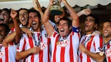 MONACO - AUGUST 27: Players of Atletico de Madrid celebrate victory with the trophy after the UEFA Super Cup match between FC Inter Milan and Atletico de Madrid at Louis II Stadium on August 27, 2010 in Monaco, Monaco. (Photo by Massimo Cebrelli/Getty Images)