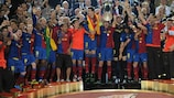 Carles Puyol hoists aloft the UEFA Champions League trophy