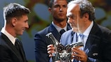 Lionel Messi receives the UEFA Best Player in Europe Award from UEFA President Michel Platini