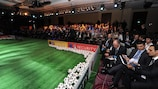 The packed grandstand of delegates at the 2013 UEFA-EU Stadium and Security Conference in Warsaw