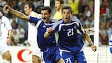 Traianos Dellas (left) celebrates his winning goal with team-mate Konstantinos Katsouranis