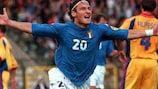 Italy's Francesco Totti takes the adulation after scoring the first goal against Romania
