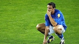 Italy midfielder Massimo Oddo looks dejected at the end of the match