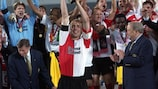 Paul Bosvelt holds up the cup for Feyenoord