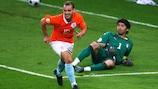 Italy keeper Gianluigi Buffon lies on the turf as scorer Wesley Sneijder wheels away