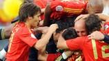 Spain celebrate David Villa's dramatic late strike