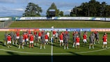 Benfica and Real Madrid pose together on the pitch ahead of the final