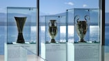 The Europa League, EURO and Champions League trophies on display at UEFA HQ