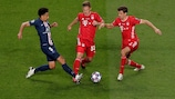 Marquinhos of Paris battles for possession with Joshua Kimmich and Thomas Müller in Lisbon
