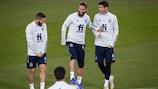 Spain's Koke and Sergio Ramos enjoy training ahead of the game