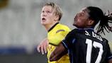 Dortmund's Erling Braut Haaland under pressure from Simon Deli