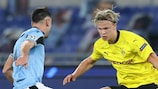 Erling Braut Haaland takes on a Lazio player