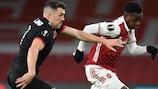 Arsenal's Eddie Nketiah has a brush with Dundalk's Brian Gartland