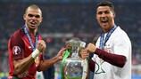 Pepe and Cristiano Ronaldo celebrate completing their UEFA Champions League-UEFA EURO 2016 double
