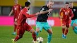 Austria's Marco Arnautović takes on Gjoko Zajkov of North Macedonia during the sides' 2019 qualifier in Vienna