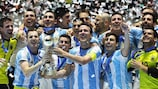 Argentina celebrate with the trophy
