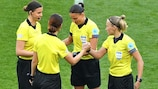 The referee team prepares ahead of the kick-off