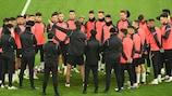 Sevilla coach Julen Lopetegui talks to his squad in Dortmund