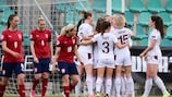 CHOMUTOV, CZECH REPUBLIC - APRIL 09: Ana-Maria Crnogorcevic of Switzerland (obscured) celebrates with Julia Stierli, Lara Marti, Luana Buehler and teammates after scoring their team's first goal during the Women's European Championship Qualifying Play Off match between Czech Republic and Switzerland at Letni Stadion on April 09, 2021 in Chomutov, . Sporting stadiums around Czech Republic remain under strict restrictions due to the Coronavirus Pandemic as Government social distancing laws prohibit fans inside venues resulting in games being played behind closed doors. (Photo by Martin Sidorjak/Getty Images)
