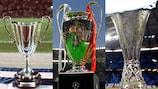 Les trois trophées UEFA, de g. à d., Coupe des coupes, Champions League, Europa League