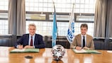 UN High Commissioner for Refugees, Filippo Grandi (L),  UEFA's football and social responsibility director, Michele Uva (R)