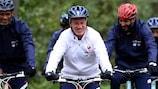 Didier Deschamps leads his France team on a bike ride at their Clairefontaine base