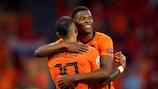 Denzel Dumfries celebrates with Memphis Depay after the Netherlands' win against Austria