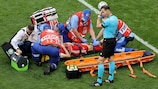 Mario Fernandes (Russia) receives medical treatment during the EURO group stage match against Finland