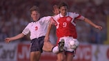 England's Stuart Pearce looks to tackle Denmark's Fleming Poulsen at the 1992 EURO