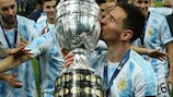 Lionel Messi kisses the trophy after leading Argentina to victory at the 2021 Copa América
