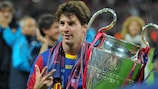 Lionel Messi celebrates with the UEFA Champions League trophy after the 2011 final