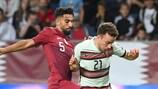 Qatar's Tarek Salman vies with Portugal's Diogo Jota