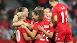 Pernille Harder is congratulated after her record-breaking goal for Denmark