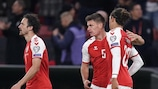 Denmark's defender Joakim Maehle (C) celebrates scoring the 1-0 with team mates Denmark's midfielder Thomas Delaney (L) and Denmark's forward Yussuf Poulsen during the FIFA World Cup Quatar 2022 qualification Group F  football match between Denmark and Austria in Copenhagen, on October 12, 2021. - Denmark OUT (Photo by Liselotte Sabroe / Ritzau Scanpix / AFP) / Denmark OUT (Photo by LISELOTTE SABROE/Ritzau Scanpix/AFP via Getty Images)